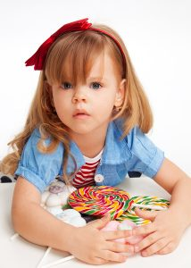 Greedy Girl With Pile Of Sweets