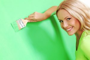 woman-painting-wall-vibrant-color