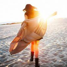 a-girl-walking-alone-on-sandy-beach-at-dawn-she-is-enjoying-sea-and-freedom-1024x640
